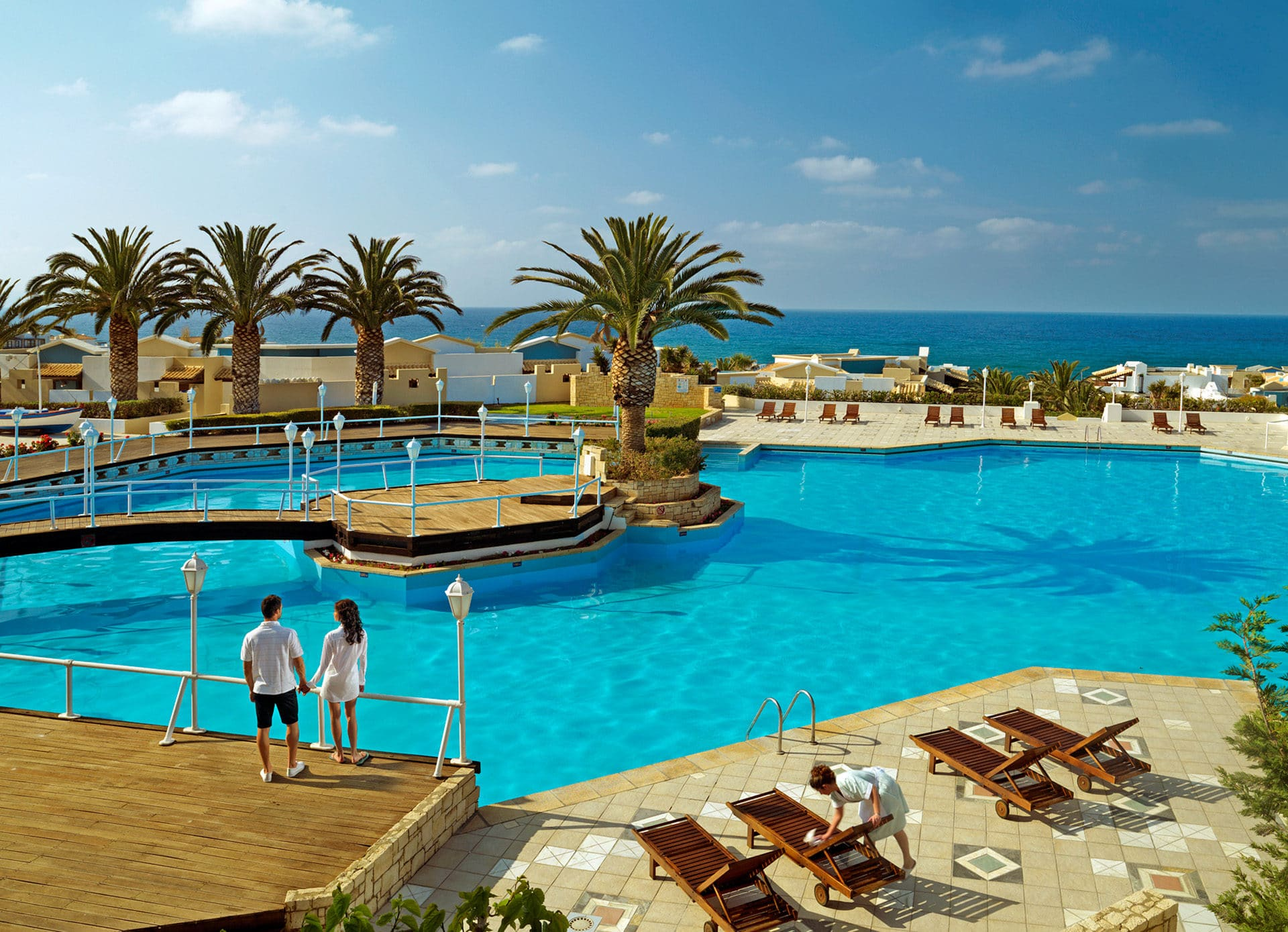 Pool Area Knossos Royal 5-star Knossos Royal Beach Resort in Crete | Book Hotel rooms online